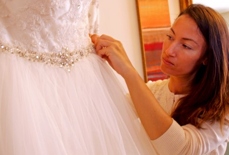 needles and stitches behind the scenes wedding gown final details dress jewels lace